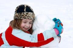 Heureux avec son bonhomme de neige Images libres de droits
