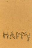 Heureux - dessiné sur une plage sablonneuse Images libres de droits