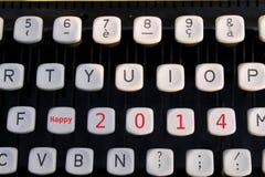 2014 heureux sur la machine à écrire Images stock