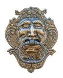 Heurtoir de trappe médiéval, découpage en bronze de tête humaine photo stock