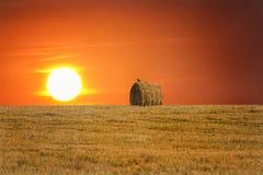 Heuschober bei Sonnenuntergang Stockbilder
