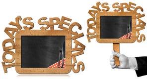 Heutige Specials - Chef Holding Chalkboard Lizenzfreie Stockfotos