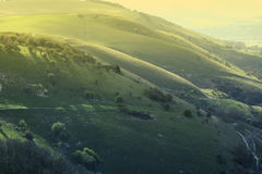 Heuvels bij zonsondergang Stock Afbeelding