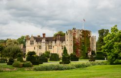HEVER CASTLE, ENGLAND, UK – SEPTEMBER 08 2018: View of Hever Castle and its topiary garden on a cloudy day royalty free stock photos