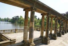 Hever castle garden's colonnade, patio at a lakeside in England Stock Image