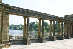 Hever castle garden's colonnade, patio at a lakeside in England Royalty Free Stock Image