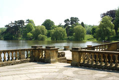 Hever castle garden's patio at a lakeside in England Royalty Free Stock Photography