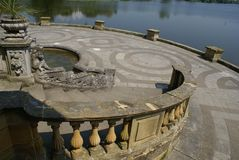 Hever castle garden's patio at a lakeside in England Stock Image