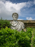 HEVER, KENT/UK - JUNE 28 : Old Statue of a Roman in the Garden a Stock Images
