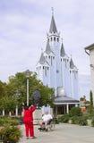 HEVIZ, UNGHERIA - AGOSTO 2013: La gente non identificata prende le immagini Immagine Stock