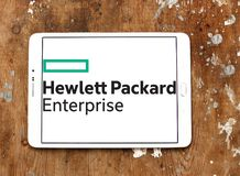 Hewlett Packard Enterprise Company logo. Logo of Hewlett Packard Enterprise Company on samsung tablet on wooden background. it is an American multinational Royalty Free Stock Images