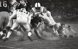 Hewritt Dixon is tackled by Roy Hilton of the Baltimore Colts. Hewritt Dixon #35 is tackled by Roy Hilton #85 of the Baltimore Colts.  Image taken from a B&W Royalty Free Stock Photos
