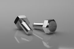 Hex Bolts on grey background. 3d Rendering. Hex Bolts on grey background. Close up. 3d Rendering Royalty Free Stock Photography