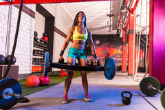 Hex Dead Lift Shrug Bar Deadlifts woman at gym. Workout weightlifting royalty free stock photos