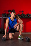 Hex dumbbells man workout in red gym Stock Photography