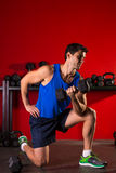 Hex dumbbells man workout in red gym Royalty Free Stock Photography