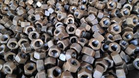 Hex nuts. Forged steel Hex nuts from a factory stock photo