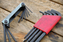 Hex set of hand tools on wooden background, Tools equipment Stock Images