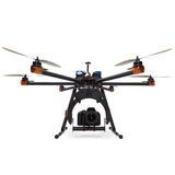 Hexacopter with camera at studio. Large hexacopter with DSLR camera at studio royalty free stock photography