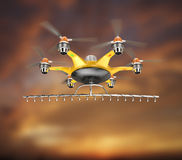 Hexacopter with crop sprayer flying in the sunset sky Royalty Free Stock Images