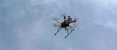 Hexacopter drone flying. An hexacopter dron flies in a sport event in Huixquilucan mexico recording some runners royalty free stock photography