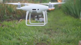 Hexacopter drone flies under grass in summer. Hexacopter drone on the grass in summer stock image
