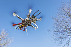 Hexacopter drone flying with camera. FORT COLLINS, CO, USA, December 2, 2014: DJI F550 Flame Wheel hexacopter drone, assembled from a kit, flying with a prosumer royalty free stock photos