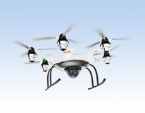Hexacopter drone with security camera hovering in the sky Stock Photos