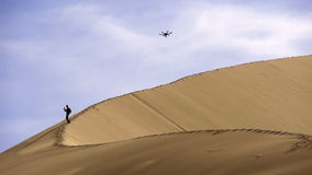 Hexacopter Over the Dunes stock video