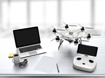 Hexacopter, remote controller, laptop on desk Stock Photography