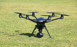 Hexacopter with Surveillance Camera. A drone, hexacopter, with a surveillance camera standing on the grass royalty free stock images