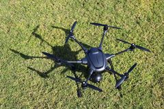 Hexacopter with Surveillance Camera. A drone, hexacopter, with a surveillance camera. View from above royalty free stock photos