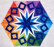 Hexagon patchwork block like kaleidoscope, detail of quilt. Hexagon patchwork block like kaleidoscope from pieces of fabrics, detail of quilt, colors of rainbow Stock Photo