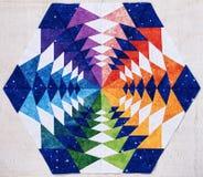 Hexagon patchwork block like kaleidoscope, detail of quilt. Hexagon patchwork block like kaleidoscope from pieces of fabrics, detail of quilt, colors of rainbow stock photography