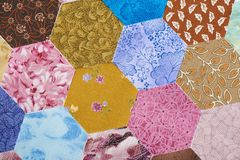 Hexagon pieces of colorful fabric random ordered royalty free stock images