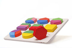 Hexagon puzzle peg round hole Stock Image