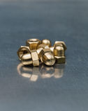 Hexagonal brass nuts Stock Photography