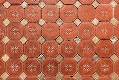Hexagonal Floor Tiles. Old Victorian hexagonal floral pattern floor tiles showing wear Stock Image