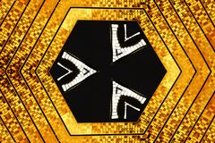 Hexagonal gold design. A view of an abstract hexagonal design with gold, black and white colors Royalty Free Stock Photos
