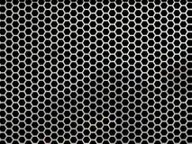 Hexagonal mesh. Hexagonal, honey comb stainless steel mesh on black stock photos