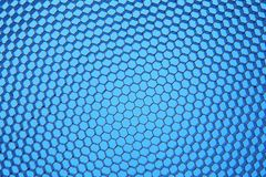 Hexagonal mesh on a blue background. Royalty Free Stock Photos