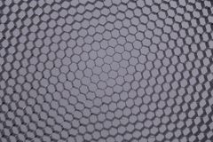 Hexagonal mesh on a grey background. Royalty Free Stock Photos