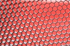 Hexagonal mesh on a red background. Royalty Free Stock Photo