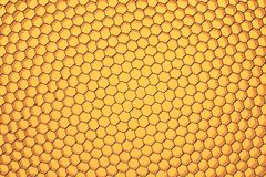 Hexagonal mesh on a yellow background. Royalty Free Stock Photo