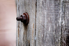 Hexagonal metal nut,with full of rust,locked with corrosion bolt Stock Image