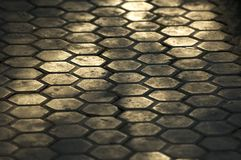 Hexagonal Path. Garden path made from hexagonal stone tiles, lit by sunlight stock photos