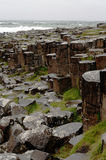 Hexagonal rocks at Giants Causeway, Northern Ireland. The Giants Causeway in Northern Ireland is a world heritage site. This image shows the predominantly Royalty Free Stock Photo