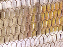 Hexagonal Shaped Grille. The grille on the window, in hexagonal shape looking like beehive Stock Images