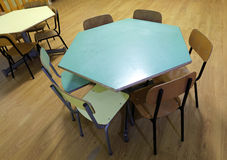 Hexagonal table with small chairs in a classroom Stock Image