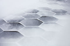Hexagonal tiles covered with snow Royalty Free Stock Photo
